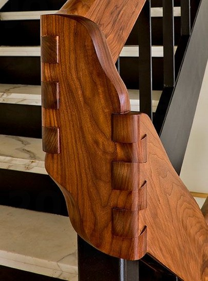 Amazing Dove Tail joinery on the stairway hand rail